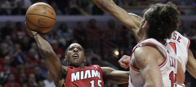 Miami Heat guard Mario Chalmers (15) looks to shoot against the Chicago Bulls defense during the first quarter of Game 5 of the NBA basketball Eastern Conference finals Thursday, May 26, 2011, in Chicago.