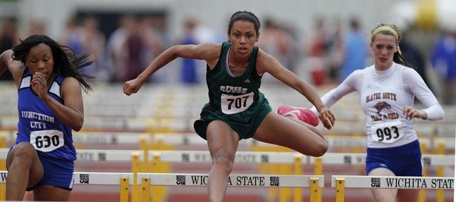 Free State's Alexa Harmon-Thomas (707) competes in the 100-meter hurdles at state. Harmon-Thomas placed second, and the Firebirds were third in the team race Saturday, May 28, 2011 in Wichita.