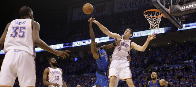 Oklahoma City Thunder's Nick Collison (4) blocks a shot by Dallas Mavericks' Jason Terry (31) in the second half of Game 4 of the NBA Western Conference finals basketball series Monday, May 23, 2011, in Oklahoma City.