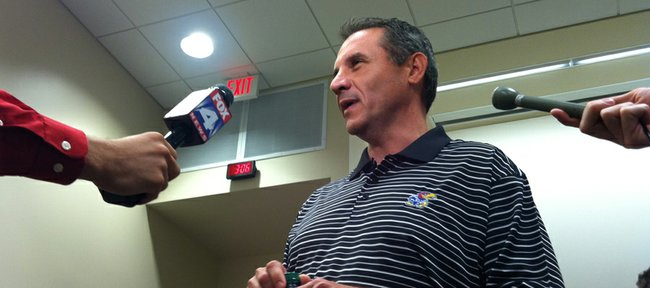 Kansas assistant coach Vic Shealy talks to reporters after being promoted to defensive coordinator on Tuesday, May 31, 2011, at the Anderson Family Football Complex.