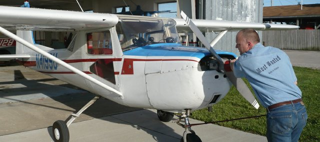 Seth Fox, of Atchison, often travels to Lawrence Municipal Airport in his Cessna 150d. It costs Fox more than $110 to fill the Cessna's tank.