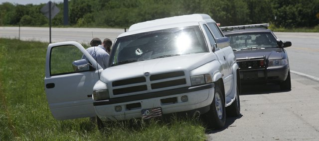 Douglas County Sheriff's officials investigate a fatality accident on the South Lawrence Trafficway near Clinton Parkway Tuesday, May 31, 2011. One person died when a piece of metal fell off an oncoming truck and went through the windshield.