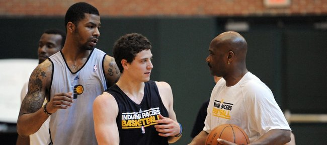 BYU's Jimmer Fredette, center, and Kansas' Marcus Morris thank the Indiana Pacers staff after a workout for the NBA basketball team Tuesday in Indianapolis.