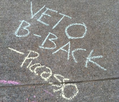 Sidewalk chalk on the south side of the capitol building expresses the feelings of Kansas Arts Commission supporters.
