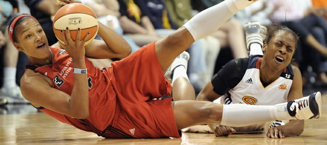 Connecticut Sun guard/forward Danielle McCray, right, goes after a loose ball against Washington's Marissa Coleman. McCray, a former Kansas University standout, led the Sun to an 89-73 victory over the Mystics in the season opener on Saturday in Uncasville, Conn.