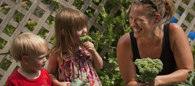 Caryl Hale, right, has a garden that provides plenty of fresh vegetables for her children including Miles, 2, and Allyson, 3. The Hale family garden is on this year's Lawrence Food Garden Tour.