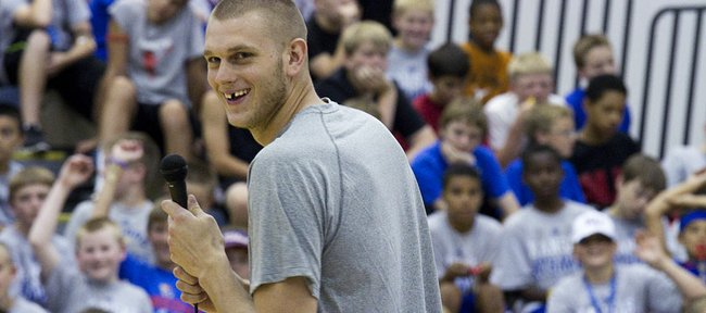 Oklahoma City Thunder player and former Jayhawk Cole Aldrich speaks before a large group of participants at the Bill Self basketball camp Monday, June 6, 2011 at Horejsi Center.