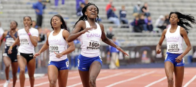 Kansas University freshman Diamond Dixon (1006) emerges ahead of the pack for a victory in the 400-meter dash in this April 23 file photo at the Kansas Relays at Memorial Stadium. Dixon, who recently was named Midwest Region Track Athlete of the Year, will compete in the NCAA Outdoor Championships today in Des Moines, Iowa.