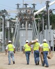 Westar employees carry parts into the substation at Sixth and Kentucky streets after a switch failure caused about 5,000 Westar customers to lose power Friday, June 10, 2011.