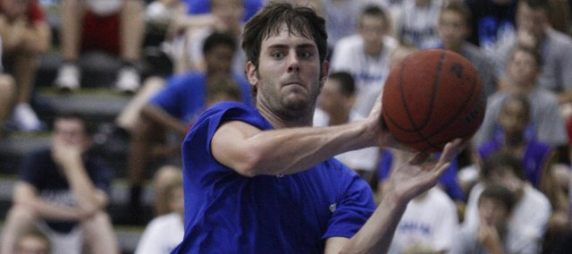 Kansas guard Conner Teahan looks to pass as Jayhawk team members run through drills during Bill Self's basketball camp Tuesday, June, 15, 2010 at the Horejsi Center.
