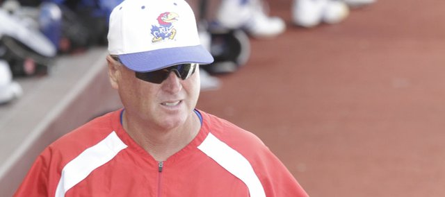 KU baseball coach Ritch Price paces in the dugout during the Jayhawks game against University of Arkansas Little-Rock on Tuesday, March 22, 2011, at Hoglund Ballpark.