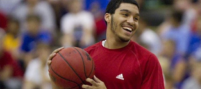 Kansas University guard Niko Roberts smiles as he listens to campers chanting for him to dunk at the Bill Self basketball camp on Tuesday, June 15, 2011 at the Horejsi Center.