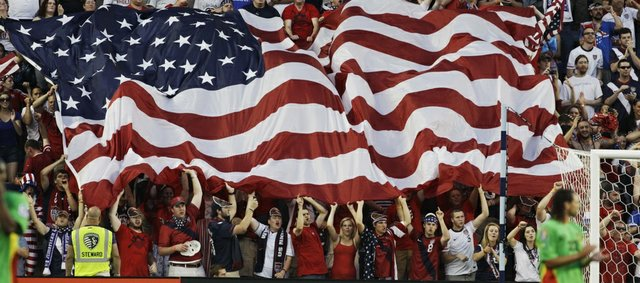 Fans wave an American flag following a U.S. goal against Guadeloupe in the Gold Cup. The U.S. prevailed, 1-0, on Tuesday in Kansas City, Kan.
