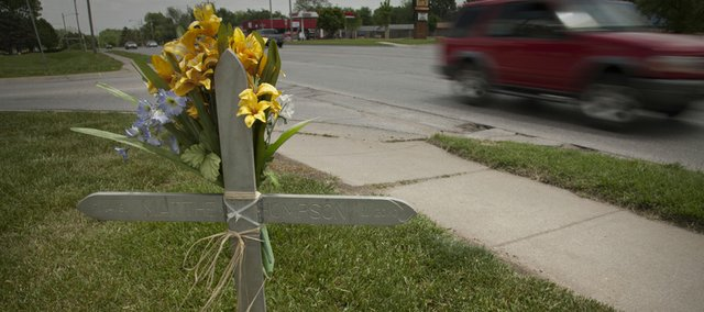 A cross marks the spot on Sixth Street where an accident killed motorcyclist Matthew Thompson in 2004.