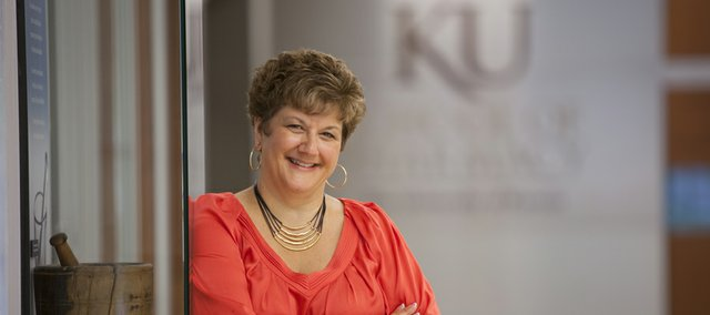 Cheryl Holcomb, director of finance and human resources for the School of Pharmacy at Kansas University, is pictured in the lobby of the building June 16, 2011. In 2010, she received the Emily Taylor award for Outstanding Woman Staff Member.