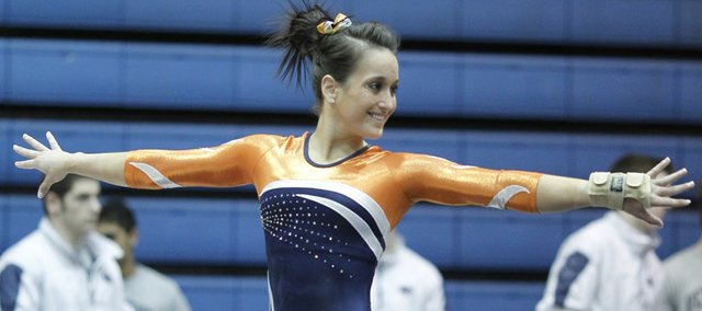 Eudora High graduate Melissa Fernandez, shown here competing on the balance beam for the University of Illinois, where she earned All-American honors three times, has traded in the hard-core world of competitive gymnastics for a chance to join the circus — literally.