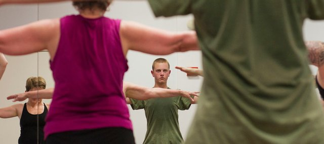 Mitch Madl, 15, participates in a bikram yoga class May 20 at Bikram Yoga Lawrence, 711 W. 23rd St.