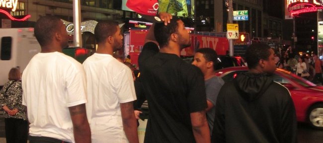 Kansas University forwards Marcus Morris (black shirt and red hat) and Markieff Morris (second from left) take a minute to soak up the scene at Times Square in New York on Wednesday, the eve of the 2011 NBA Draft. Joining the Morris twins are, from left, Sean Evans, Julius Kane and Guy Lipscomb.