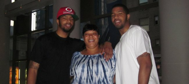 Kansas University forwards Marcus Morris, left, and Markieff Morris, right, flank their mother, Angel, inside the Westin Times Square in New York on Wednesday, June 20, 2011. Angel was the first recipient of Headquarters Counseling Center's Life Saver Award.  The center is seeking nominations for its 2012 recipient.