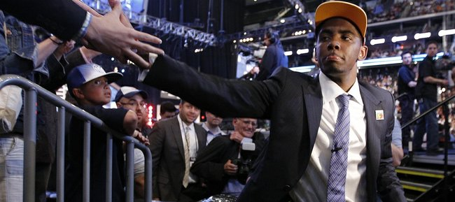 Former Duke guard Kyrie Irving is congratulated after being taken with the No. 1 overall pick by the Cleveland Cavaliers in the NBA Draft on Thursday in Newark, N.J.