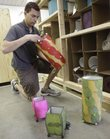 Chris Godfrey, a co-owner of Eangee, at 1380 N. Third St., packs some lamps for shipment. Eangee received a small-business loan to help the lamp and home furnishings company grow.