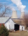 This March 16, 2011, photo shows steam rising from cooling towers at Exelon Corp.'s nuclear plant in Byron, Ill. Exelon, which has acknowledged violating Illinois state groundwater standards, agreed to pay $1.2 million to settle state and county complaints over the tritium leaks in Illinois' Braidwood, Dresden and Byron sites. The NRC also sanctioned Exelon.