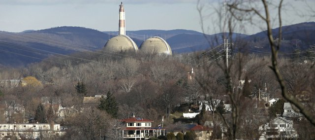 The reactor containment domes of the Indian Point nuclear power plant in Buchanan, N.Y., rise above the homes just north of the town of Verplanck, N.Y., as seen from the Stony Point Historic Site, December 16, 2009.