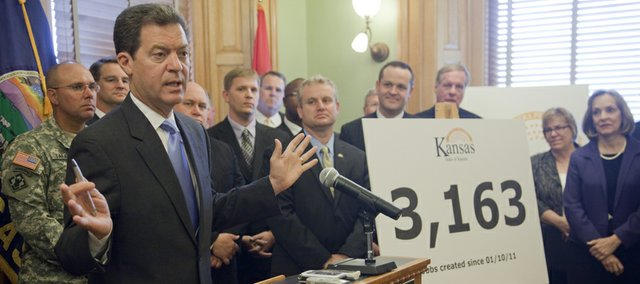 Gov. Sam Brownback provides a progress report on his first six months in office Wednesday, July 6, 2011, at the Statehouse in Topeka. Brownback was joined by Cabinet secretaries and executive directors of state agencies and programs.