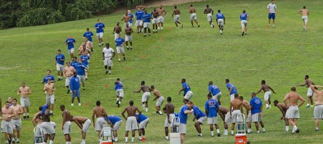 Kansas University football players go through workouts on the Campanile Hill. Upperclassmen led the voluntary workouts on Thursday on the KU campus.