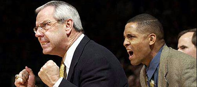 Neil Dougerty, right, is shown alongside former KU coach Roy Williams in this 2002 file photo. CBSSports.com is reporting that Dougherty has died at the age of 50.