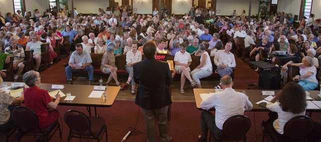A crowd fills Plymouth Congregational Church, 925 Vermont Street, for a public forum on Gov. Sam Brownback's administration's decision to close the Lawrence office of the Kansas Department of Social and Rehabilitation Services. The forum was held Monday, July 11, 2011.