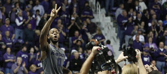 Kansas State guard Jacob Pullen celebrates with the Bramlage Coliseum crowd following the Wildcats' 84-68 upset win over Kansas on Monday, Feb. 14, 2011.