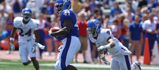 Nick Krug/Journal-World Photo.Kansas tight end Jimmay Mundine looks to run after a reception during the Kansas Spring Game on Saturday, April 30, 2011 at Kivisto Field. On defense are safety Keeston Terry (9) and safety Bradley McDougald (24).