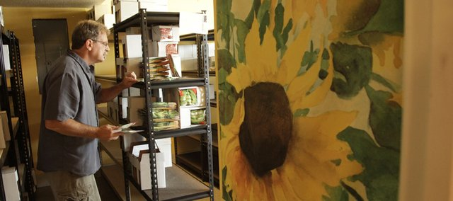 Dan Nagengast sorts seeds in his home office. For almost 20 years, Nagengast was the director of the Kansas Rural Center. Recently, he and his wife, Lynn Byczynski, bought Seeds from Italy, a seed company that sells Franchi seeds.