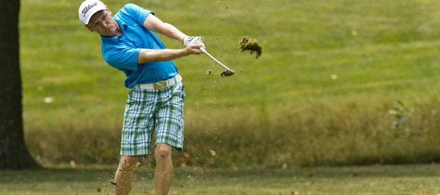 Spencer Wilson follows through on a shot on the first hole at Lawrence Country Club. Wilson went on to win the open championship flight of the LAGA city tournament on Sunday.