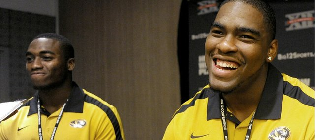 Missouri safety Kenji Jackson, left, and defensive lineman Jacquies Smith joke around between questions during NCAA college football Big 12 Media Days, Monday, July 25, 2011, in Dallas.