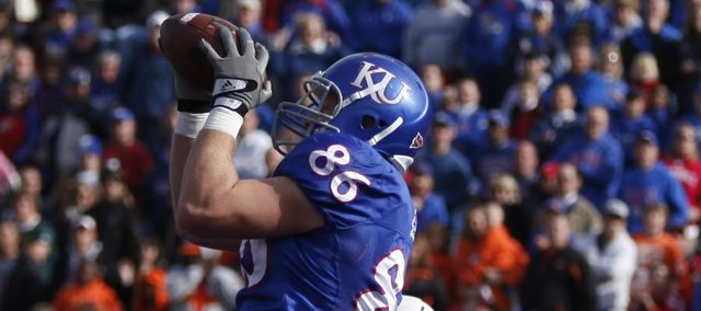 Kansas receiver Tim Biere catches a touchdown pass before Oklahoma State linebacker James Thomas during the first quarter, Saturday, Nov. 20, 2010 at Kivisto Field.