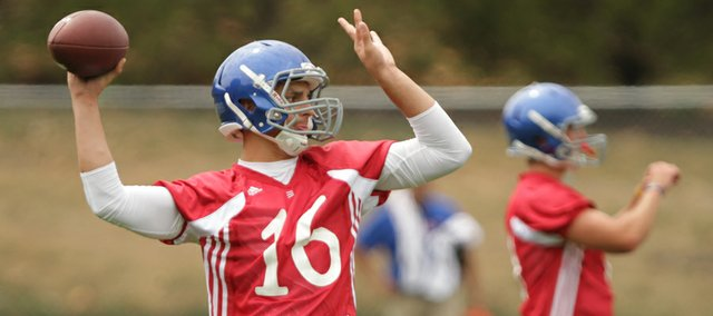 Freshman quarterback Brock Berglund works out with the quarterbacks during the team's first practice on Thursday, Aug. 4, 2011.