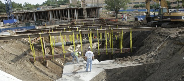 Workmen dig deep for a new 34,600-square-foot engineering building on the Kansas University campus, which will house a number of multidisciplinary research laboratories.