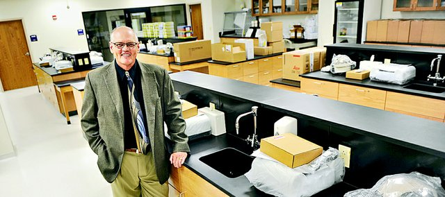 Bob Emerson is the new associate dean for the KU School of Pharmacy's Wichita campus. He is shown in a not-quite-unpacked new pharmacy lab in Wichita earlier this summer.