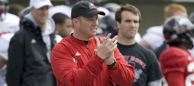 Northern Illinois coach Dave Doeren offers encouragement from the sideline during a Huskies practice. Doeren served as Kansas University co-defensive coordinator in 2005 and recruited some of the most memorable names to Lawrence. NIU will visit Kansas this season for a Sept. 10 contest in Memorial Stadium.