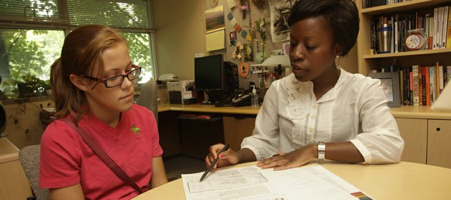 From left, KU junior Lauren Eighme, of Overland Park, gets some help from KU graduate student Maggie Osei. Eighme is getting ready to enter the Teacher Preparation Program at KU, which is now a four-year program.