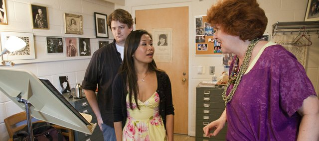 Music professor Joyce Castle, right, works closley with doctoral students Benjamin Cleveland and Etta Fung in her studio at Murphy Hall.