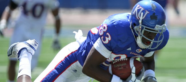 Kansas receiver Chris Omigie pulls in a pass for a 33-yard gain during the Kansas Spring Game on Saturday, April 30, 2011 at Kivisto Field.