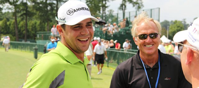Former Kansas University golfer Gary Woodland, left, visits with legendary golfer Greg Norman, center, and PGA professional Dan Rooney on the driving range at the Atlanta Athletic Club, where Woodland will compete beginning today in the PGA Championship.
