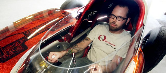 Roy Fields sits in the fuel-modified roadster in his shop in Hutchinson. Roy will be driving the car at the Bonneville Salt Flats in attempt to break the ground speed record for its class of 247.7 miles per hour.