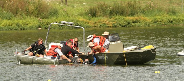 Divers from a Douglas County rescue team work to locate the body of a Tonganoxie man Saturday, August 13, 2011. The man drowned while swimming with friends.