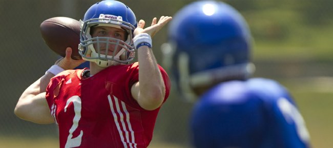 Kansas University Quarterback Jordan Webb prepares to pass to a receiver as the Jayhawks run through plays during practice on Tuesday at the KU practice fields. Kansas coaches haven't officially named a starting quarterback, but the sophomore Webb figures to be the favorite entering the fall season.