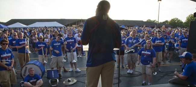 Kansas football head coach Turner Gill spoke to the crowd Friday during the sixth annual KU KickOff At Corinth Square in Prairie Village.
