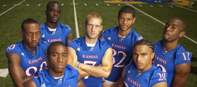 Kansas receivers, clockwise from front left, Daymond Patterson, Ricki Herod, Chris Omigie, Kale Pick, Andrew Turzilli, Christian Matthews and D.J. Beshears.